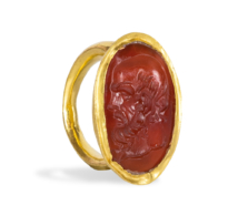 68 A Hellenistic Gold Ring with Carnelian Intaglio of the head of Socrates