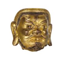 128 A Yuan Gilt Bronze Head of a guardian
