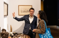 Damian Hoare showing objects to Frieze week visitors at The Natural World exhibition, Oliver Hoare Ltd