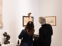 Ann Corne showing meterite slices to Frieze week visitors at The Natural World exhibition, Oliver Hoare Ltd