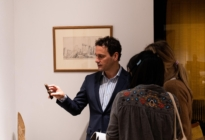 Damian Hoare showing objects to visitors at The Natural World exhibition, Oliver Hoare Ltd